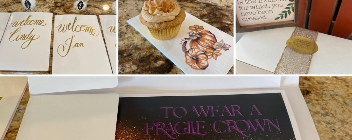 Four sections, first with white folders and gold lettering, second with gold and caramel-colored cupcake on white napkin with pumpkin, third with white box, gold web ribbon, gold sticker with black lettering, off-white wooden sign with black cursive lettering and green leaves, pumpkin in background, fourth section white folder containing cover of our study To Wear a Fragile Crown